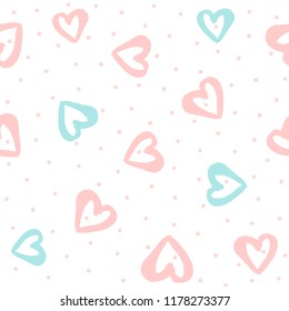Repeated round dots and hearts drawn by hand with watercolour brush. Cute seamless pattern. Endless girly print. Vector illustration.