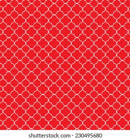 Repeating red and white quatrefoil trellis pattern