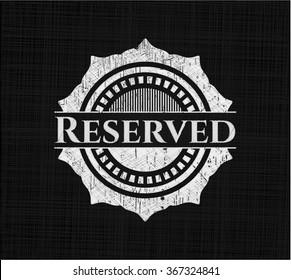 Reserved chalkboard emblem written on a blackboard