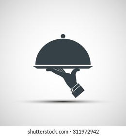 Restaurant cloche in hand the waiter. Logo design. Stock vector image.