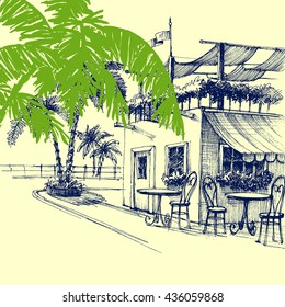 Restaurant on the beach. Terrace and palm trees