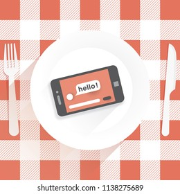 Restaurant table with knife and fork and plate with mobile phone with hello message internet web page on screen. Idea - unusual concept of modern social networking, virtual life, online chats