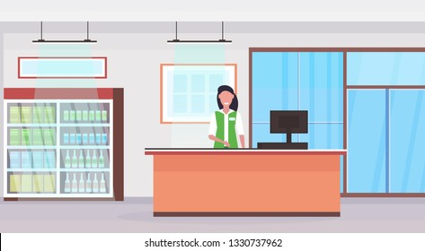 retail woman cashier at checkout counter supermarket saleswoman in uniform shopping concept grocery market interior flat horizontal