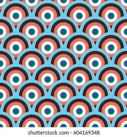 Retro 60-s geometric seamless pattern with blue and orange circles and waves. Vector illustration for background, wrapping paper, textile print, wallpaper, package, greeting card.