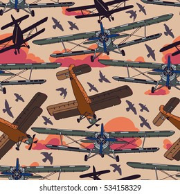 Retro airplane on the sunset sky. Vector seamless pattern