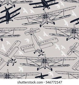 Retro airplanes with birds. Vector seamless pattern