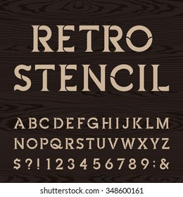 Retro alphabet stencil font. Letters, numbers and symbols on the dark wood textured background. Vintage vector typography for labels, headlines, posters etc.