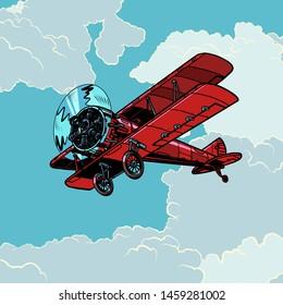 retro biplane plane flying in the clouds. Pop art vector illustration vintage kitsch