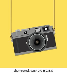 Retro camera in a flat style yellow background. Old camera with strap. Vector