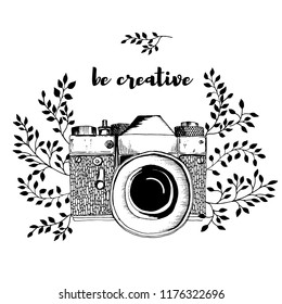 Retro camera with leaves decor. Sketch hand drawn illustration vintage style. Black and white. Inscription: be creative