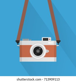 Retro camera or vintage camera in a flat style on a colored background.