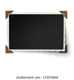 Retro figured edges photo frame with one not fixed turned up corner in vintage brown photo corners isolated on white background
