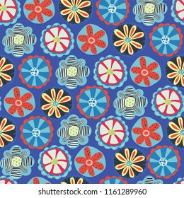 Retro flower seamless vector background. 1960s, 1970s floral design. Red, blue, and yellow doodle flowers on a blue background. Vintage flower pattern for fabric, paper, wallpaper, web banners, kids