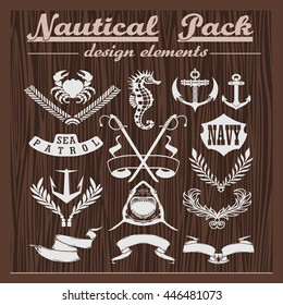 Retro pack of nautical elements, logos and badges on a wooden background