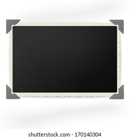 Retro photo frame in vintage photo corners isolated on white background