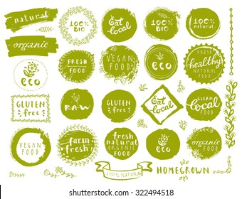 Retro style set of 100% bio, organic, gluten free, eco, healthy food labels. Organic food logo templates, floral and vintage elements in green color for restaurant menu or food package. Vector badges