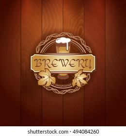 Retro styled gold logo of pub or craft brewery beer on vector vintage wood texture