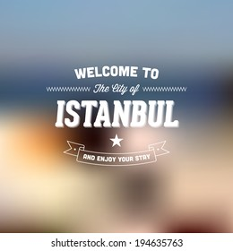 "Retro Typography. Travel label on blurry background - ""Welcome to the city of Istanbul, and enjoy your stay"". Vector design."