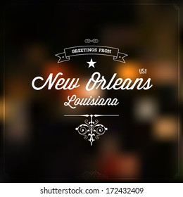 """Retro Typography, Vintage Touristic Greeting label on blurry background """"Greetings from New Orleans, Louisiana, USA"""", Vector design."""