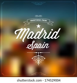 "Retro Typography, Vintage Travel Greeting label on blurry background ""Greetings from Madrid, Spain"", Vector design."