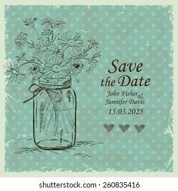 Retro wedding invitation with mason jar and chamomile flowers on a polka dot background. Save the date concept.