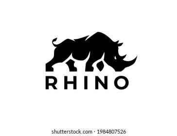Rhino logo template. Endangered African Rhinoceros silhouette icon. Horned animal symbol. Wild beast company strength sign. Vector illustration.