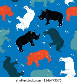 Rhino vector seamless pattern isolated on blue background. African motive for fabric, textile, wallpaper. Black, blue, white, red, green rhinoceros