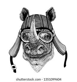 Rhinoceros, rhino wild biker animal wearing motorcycle helmet. Hand drawn image for tattoo, emblem, badge, logo, patch, t-shirt.