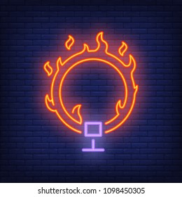 Ring on fire neon icon. Circus flaming hoop on dark brick wall background. Night bright advertisement. Vector illustration in neon style for circus performance or dangerous trick