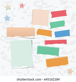 Ripped colorful note, notebook, copybook paper strips stuck on gray background.