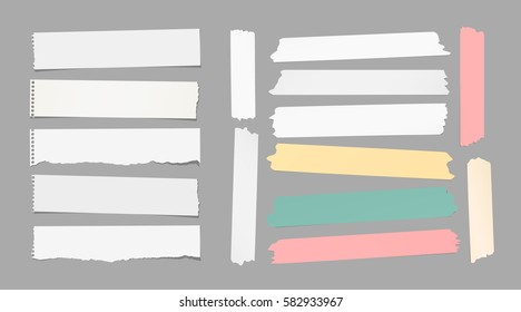 Ripped white notebook, copybook, note paper strips, colorful sticky, adhesive masking tape stuck on gray background