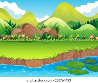 River scene with lawn and mountains