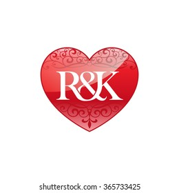 R&K initial letter logo with ornament heart shape