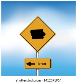 Road trip to Iowa,Yellow and black interstate highway road sign with word  Iowa  and map of Iowa with sky background