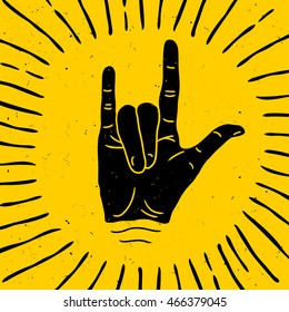 Rock hand sign silhouette with rays. Vector logo / label / tattoo
