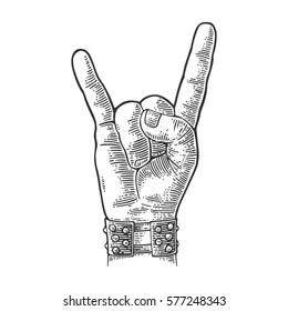 Rock and Roll hand sign. Hand with metal spiked bracelet giving the devil horns gesture. Vector black vintage engraved illustration. Isolated on white background.