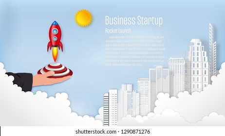 Rocket launch with building on the clouds and blue sky as paper art, craft style and business Startup project concept. flat design vector illustration.