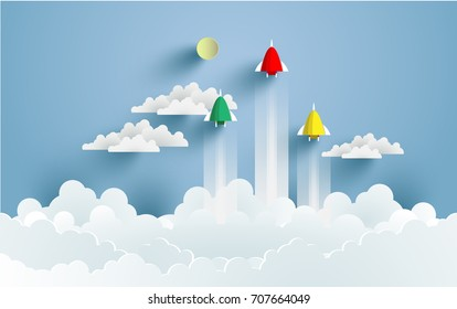 rockets flying over clouds. art paper and crafts. vector landscape illustration