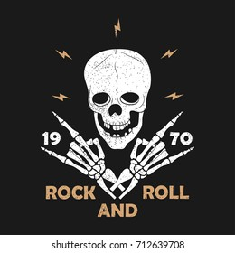 Rock-n-Roll music grunge typography for t-shirt. Clothes design with skeleton hands and skull. Graphics for clothes, print, apparel. Vector illustration.