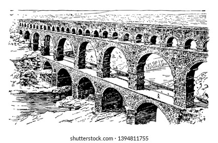 A Roman Aqueduct ancient Nemausus in southern France the emperor Antoninus Pius vintage line drawing or engraving illustration.