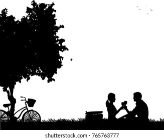 Romantic couple in picnic, with bike in park under the tree toast with glass of wine silhouette, one in the series of similar images