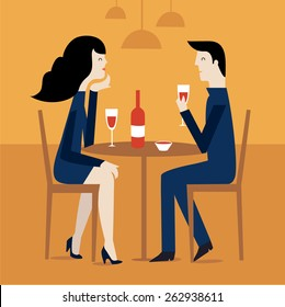 Romantic couple sitting in cafe - sharing a bottle of wine.
