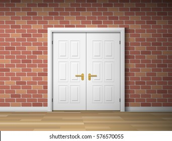 room interior with white door and brick wall