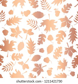 Rose Gold foil autumn leaf silhouettes seamless vector background. Copper shiny abstract fall leaves shapes on white background. Elegant pattern for digital paper, Thanksgiving card, party invitations
