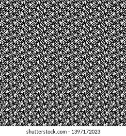 Roughly flecked fabric. Tweed texture. Graphics dots. Monochrome. Vector illustration.