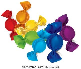 Round candy in a wrapper. Candy wrappers all colors rainbow
