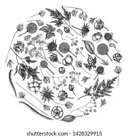 Round floral design with black and white astilbe, craspedia, blue eryngo, lagurus, cotton, gypsophila