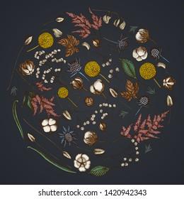 Round floral design on dark background with astilbe, craspedia, blue eryngo, lagurus, cotton, gypsophila