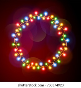 Round frame of Christmas lights. Colorful garlands circle, background.