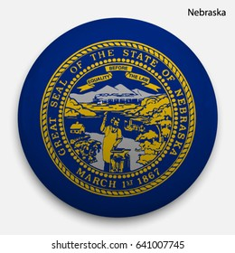 Round glossy Button with flag of Nebraska, state of the USA, with the reflection of light and shadow realistic.